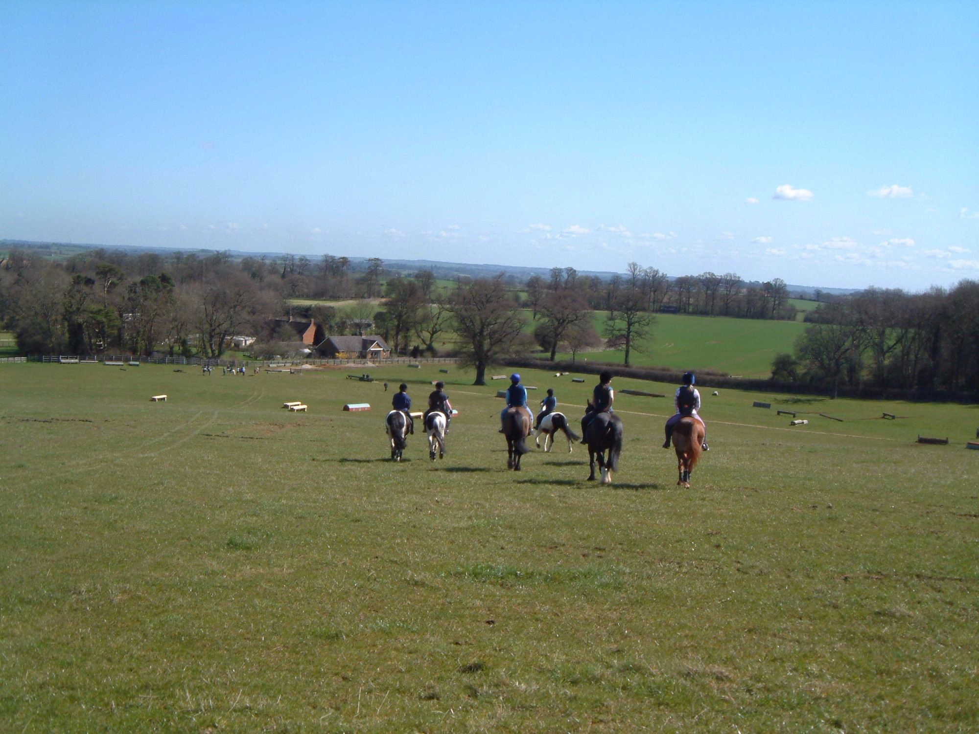 group riding down the hill xc