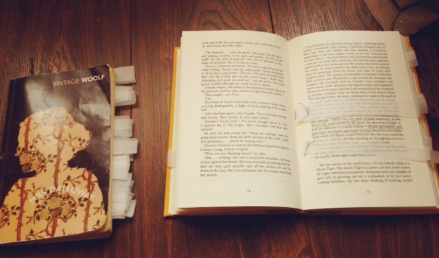 A closed and an open book, both with strips of tracing paper sewn into the pages