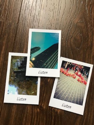 Polaroid pictures with the word 'listen' written at the bottom
