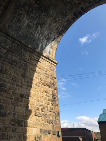 Railway arch against blue sky