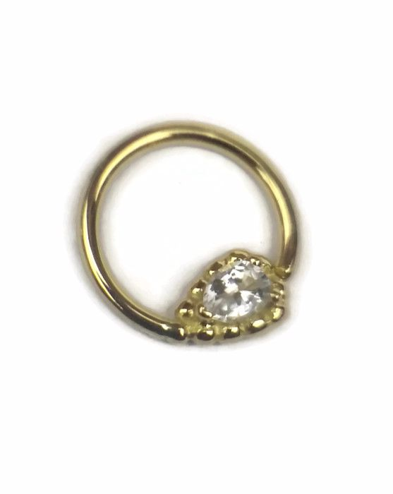Ashru, 18 carat yellow gold seam ring with white sapphire