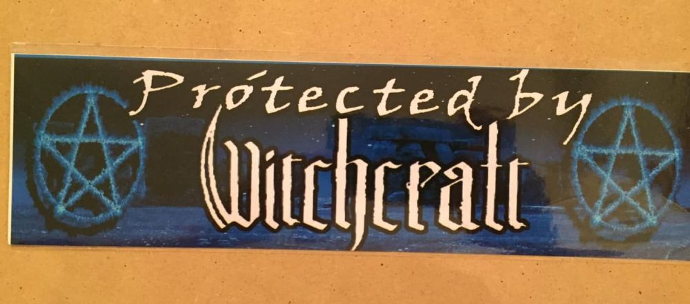 Fun bumper sticker, Protected by witchcraft