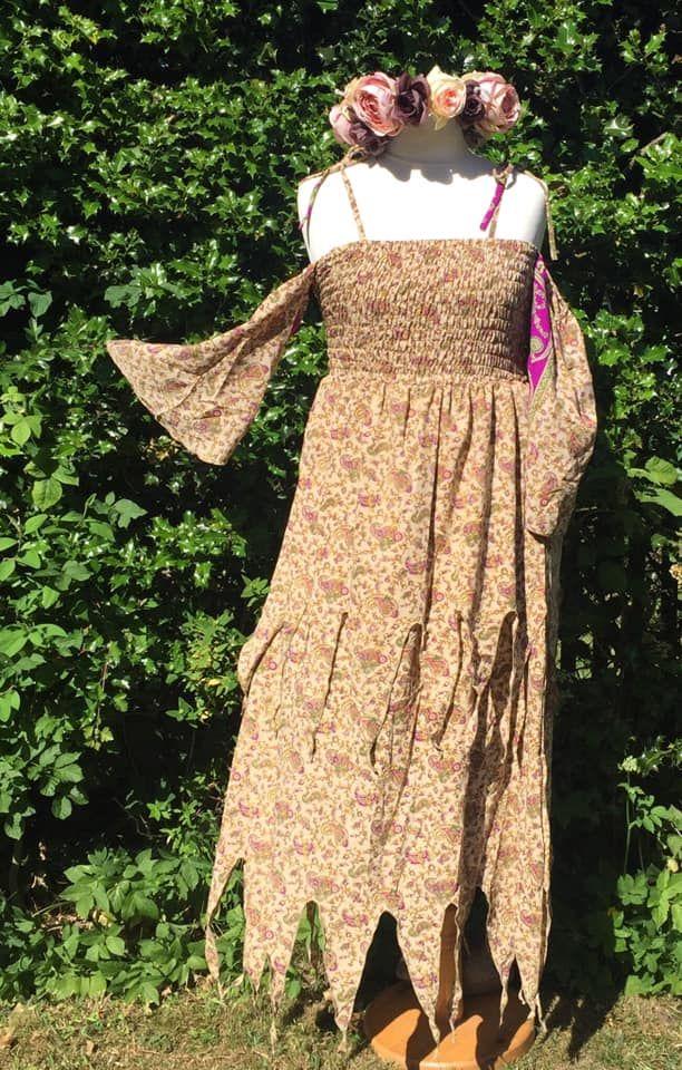 The    pixie hem cold shoulder dress