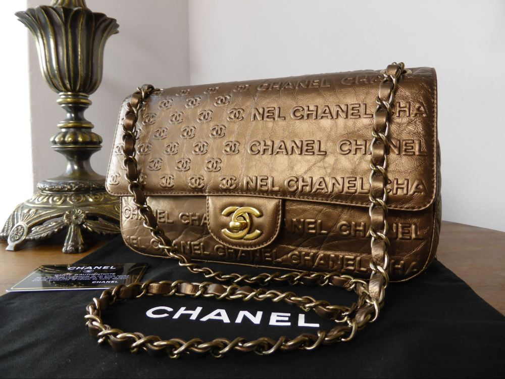 Chanel Symbols Flap in Bronze Metallic Calfskin with Antiqued Gold Hardware