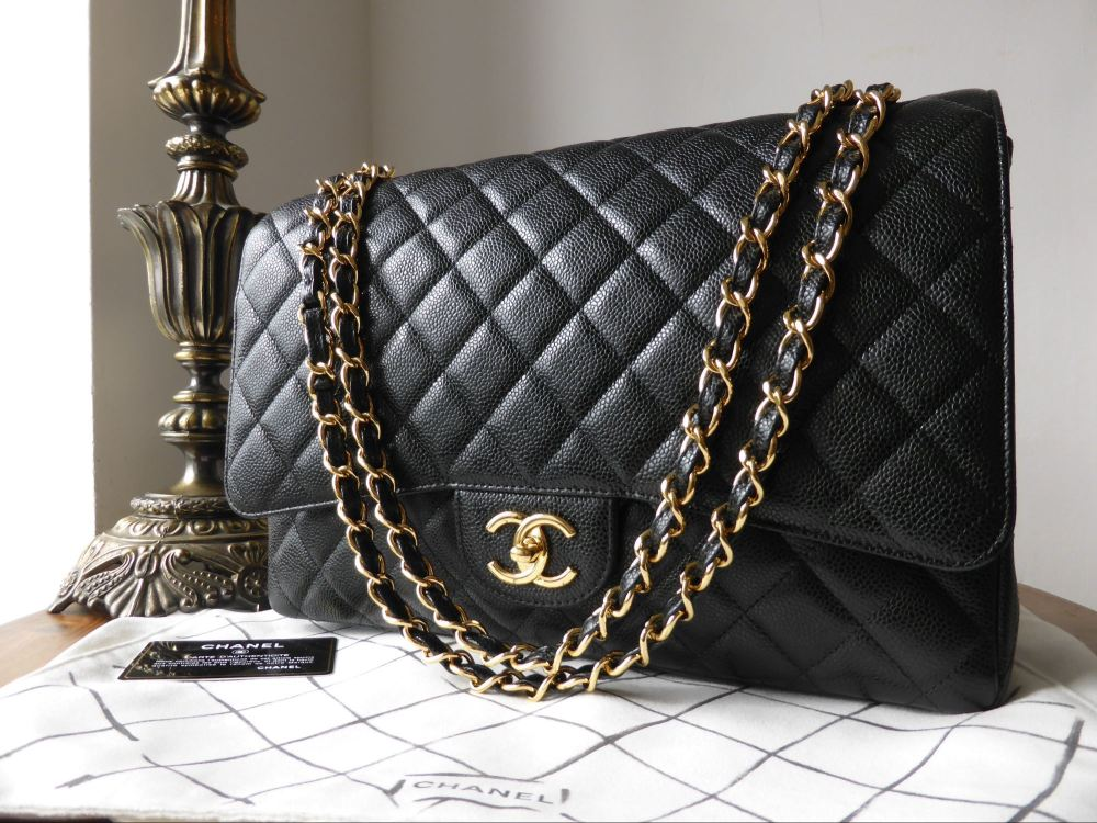 Chanel Timeless Classic 2.55 Maxi Flap Bag in Black Caviar with Gold Hardwa