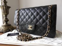 d9a427f34a7c Chanel Timeless Classic 2.55 Jumbo Flap Bag in Black Caviar with Gold  Hardware - SOLD