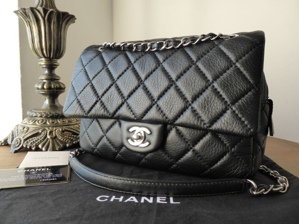 0c2245e1cc74 Chanel Medium Easy Flap Bag in Black Aged Calfskin with Silver Hardware.