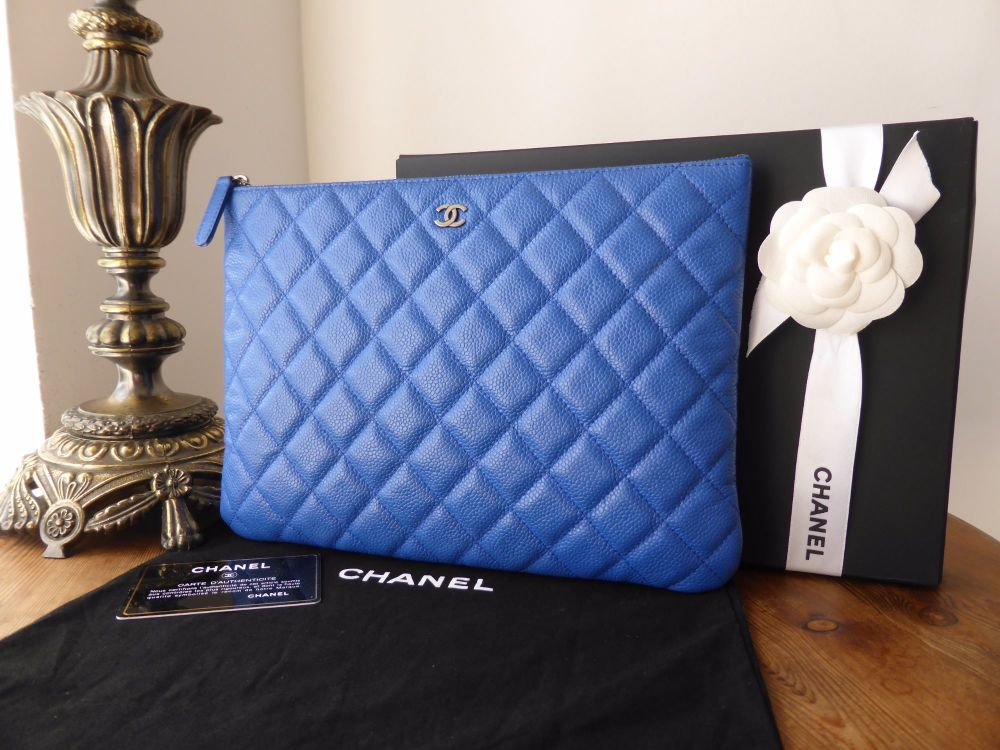 Chanel O Case in Bright Blue Caviar Leather with Ruthenium Hardware - New