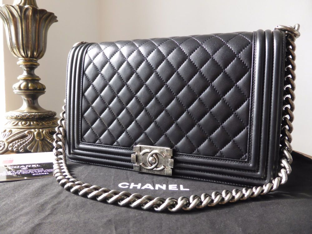 b72a1baf7e3 Chanel New Medium Boy Bag in Black Lambskin with Ruthenium Hardware