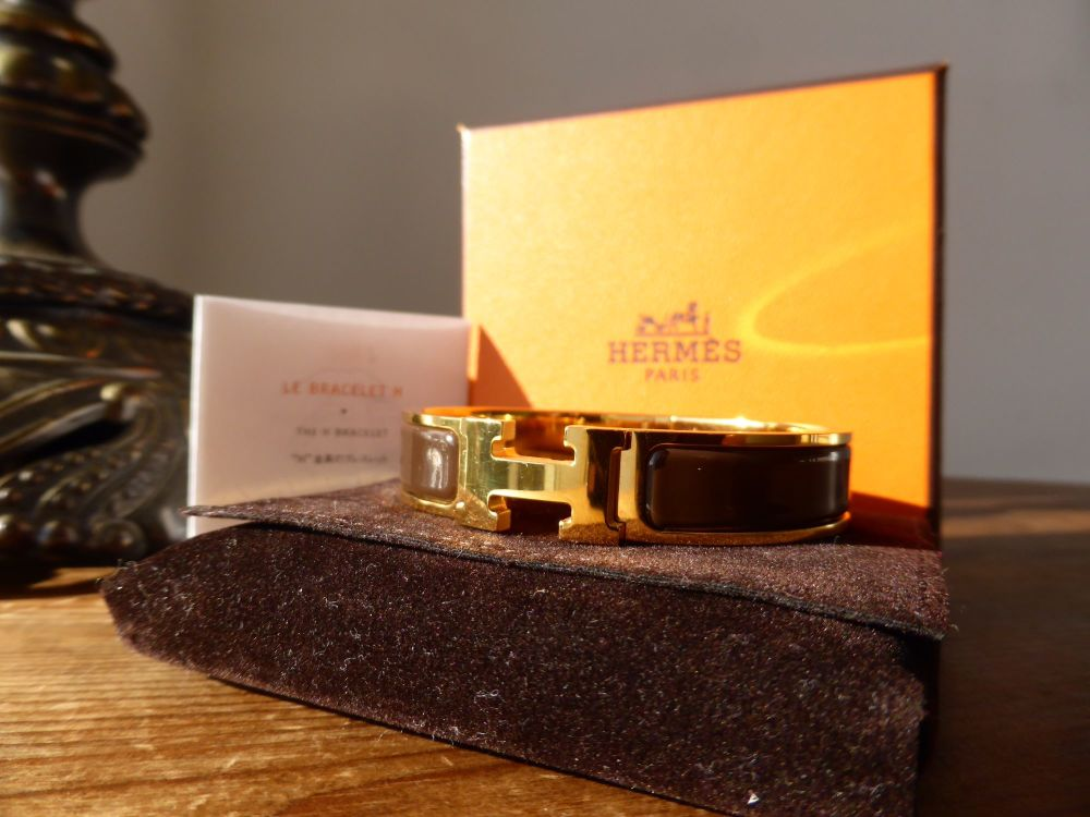 Hermés Clic H PM in Gold Cachou