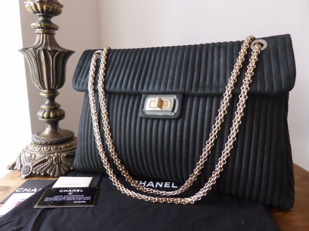Chanel Vertical Quilted Mademoiselle Lock Shoulder Bag