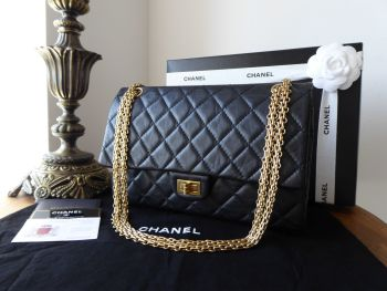 Chanel 226 Reissue Mademoiselle Flap in Distressed Black Calfskin with Gold Jewellery Chain