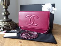 Chanel Classic Wallet on Chain WoC in Raspberry Caviar Leather with Dark Silver Hardware.