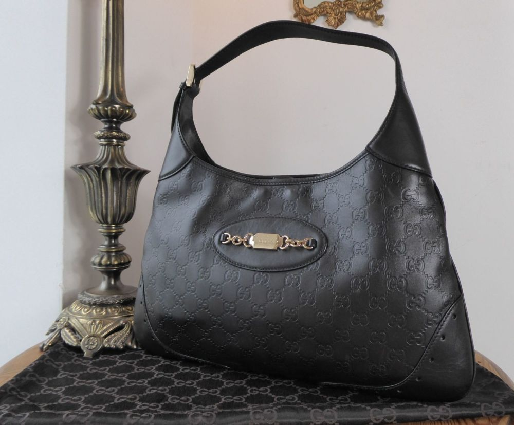1c35652928bf8e Gucci Large Punch Hobo in Black Guccissima Leather - SOLD