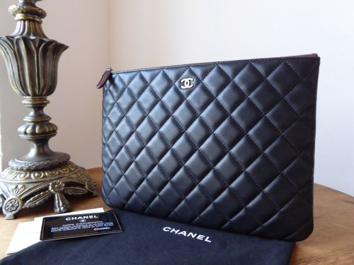 Chanel Medium Zipped O Case in Black Calfskin with Brushed Gold Hardware