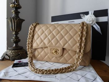 Chanel Timeless Classic 2.55 Double Jumbo Flap in Beige Clair Caviar with Gold Hardware
