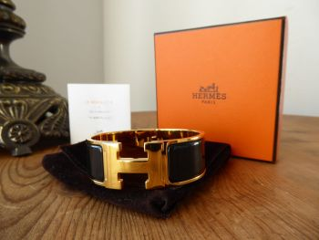 Hermés Clic Clac H Wide Cuff Bracelet PM in Gold with Black Enamel - SOLD