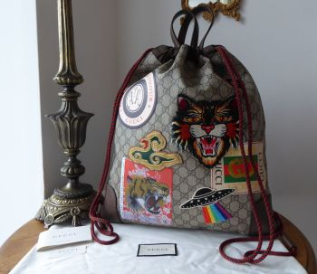 Gucci Courrier Soft GG Supreme Drawstring Backpack in Ebony Beige Monogram - As New*