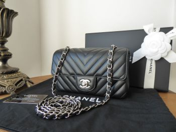 Chanel Chevron Quilted Rectangular Mini Flap Bag in Black Lambskin with Shiny Silver Hardware