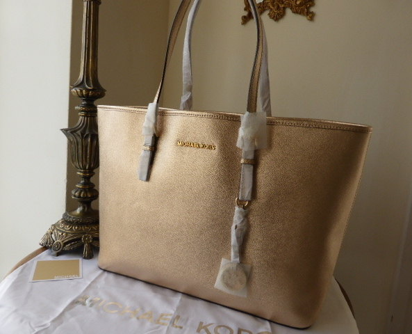 24abf527d65a Michael Kors Large Jet Set Multifunction Travel Tote in Pale Gold Saffiano