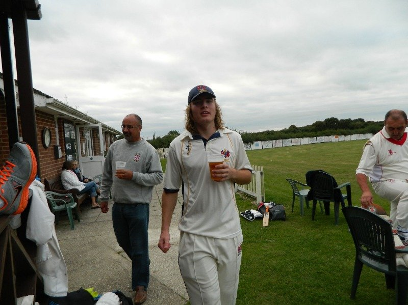 Glenn enjoying a well earned drink after a match changing 91