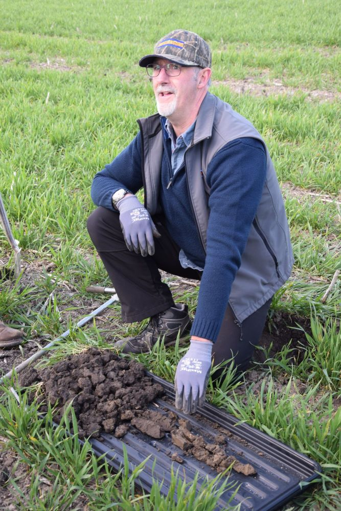 Dick Neale shows the depth of soil that is sampled