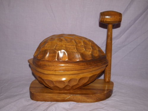 Large Wooden Nutcracker In The Shape Of A Walnut And Mallet.