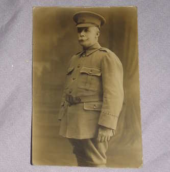 Postcard Photograph of WW1 Officer Standing.