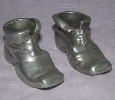 Pair of Pewter Boots.