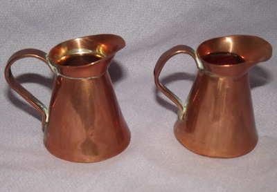 Two Miniature Copper Jugs.