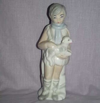 Sango Figure of a Boy with a Lamb.