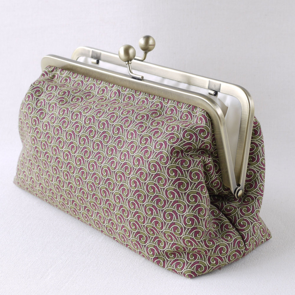 Purple scrolls kisslock clutch bag