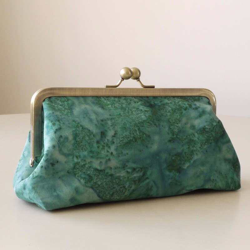 Purse style clutch bag