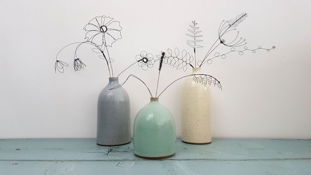 Wire flowers in vases