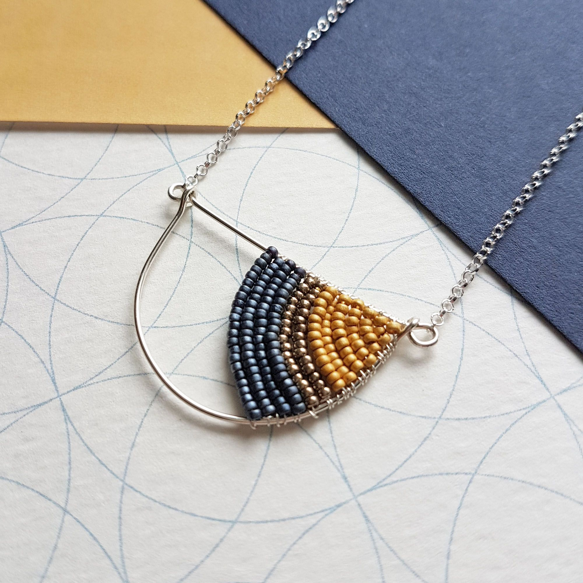 Mustard geometric necklace by Judith Brown