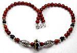 Agnetha - handmade Viking-era lampwork bead with red jasper beads