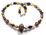 Pierrette - handmade lampwork bead with multicoloured pearls