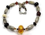 Bronte - fossil beads teamed with ivory, amber and black glass