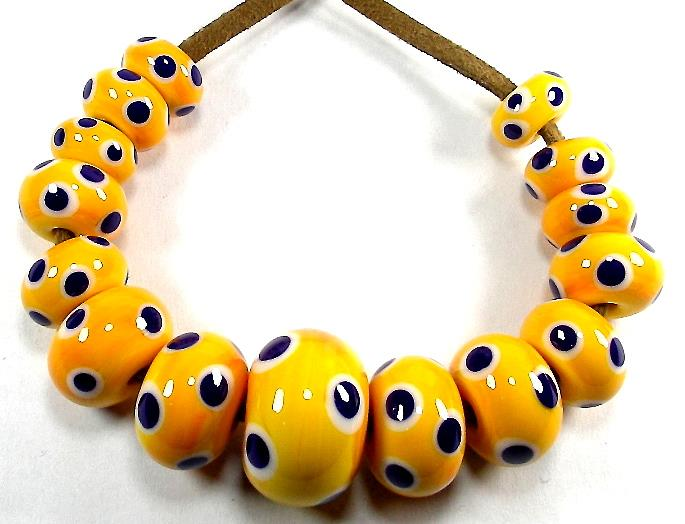 Handmade glass eye beads in yellow, blue and white, common to all time periods including Roman, Anglo-Saxon and Viking.