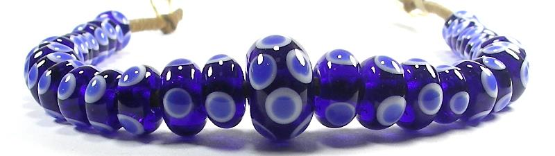 Handmade glass eye beads in cobalt blue and white, common to all time periods including Roman, Anglo-Saxon and Viking.