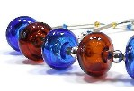 'Caryn' - hollow glass beads in amber and sapphire blue