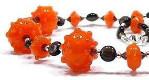'Olwen' - bright orange hollow lampwork with smoky quartz accents