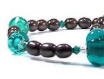 'Amalthea' - Transparent teal lampworked melon and bicone bead necklace with rock crystal, bronze pearls, Swarovski crystals