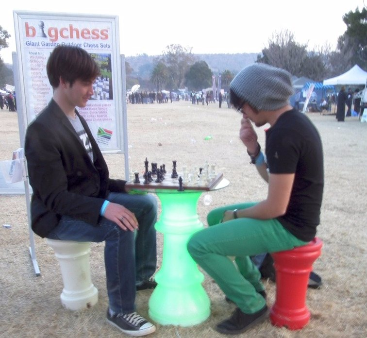 """""""Small"""" Chess players at a green queen table"""