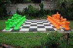 lime green and orange chess set