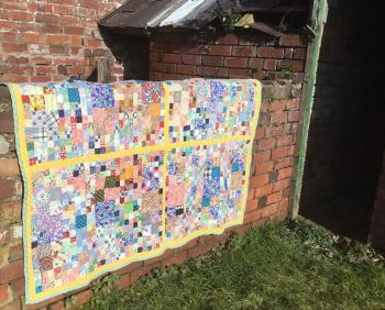 Patchwork Quilt handstitched from reclaimed vintage fabric scraps