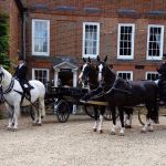 postillon horses and driven carriage