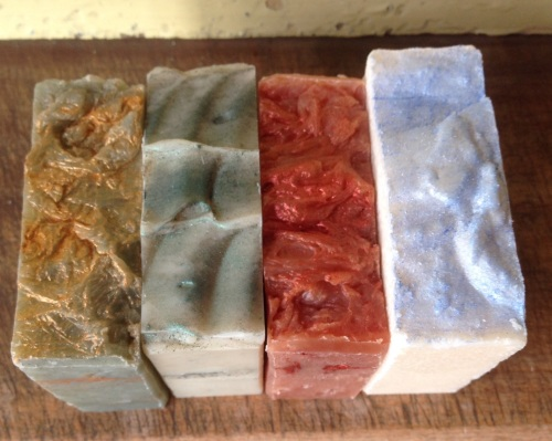 quartet of handmade soaps - christmas selection, presented in a gift box.