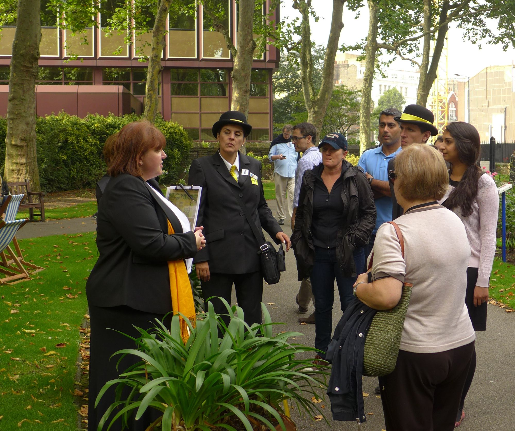 Tina leading a tour to a small group in Paddington Street Gardens in Marylebone