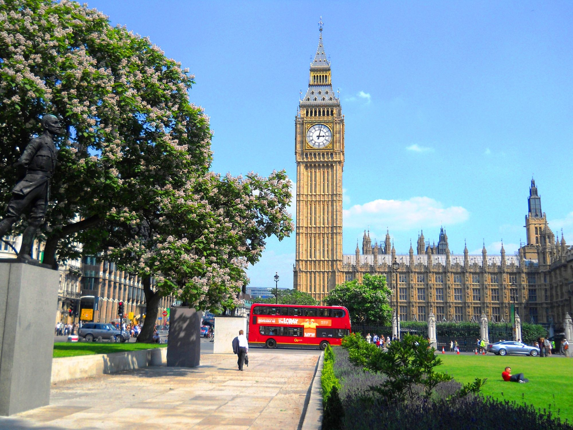 Photo of Big Ben and the Houses of Parliament. Photo is taken from the gardens in the middle of  Parliament Square.
